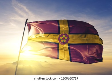 Northamptonshire county of England flag textile cloth fabric waving on the top sunrise mist fog