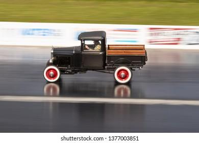 Northamptonshire, UK, Santa Pod Raceway, April 13 2019. VHRA Vintage Hot Rod Association, Vintage Nationals. Vintage hot rod Ford Pickup in motion on the drag strip.