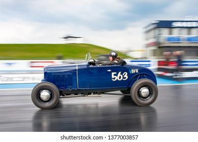 Northamptonshire, UK, Santa Pod Raceway, April 13 2019. VHRA Vintage Hot Rod Association, Vintage Nationals. Vintage hot rod in motion on the drag strip.