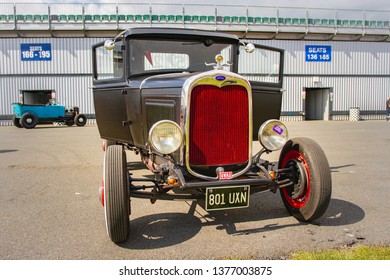 Northamptonshire, UK, Santa Pod Raceway, April 13 2019. VHRA Vintage Hot Rod Association, Vintage Nationals. Front view of Old Ford Pickup in the paddock.