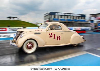 Northamptonshire, UK, Santa Pod Raceway, April 13 2019. VHRA Vintage Hot Rod Association, Vintage Nationals. Vintage hot rod Lincoln Zephyr in motion on the drag strip.
