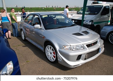 NORTHANTS, ENGLAND - MAY 11: Silver Mitsubishi Lancer on Display at the Annual Rising Performance, Tuning, Modified on May 11, 2008 in Northants, England, UK.  Santa Pod is host to the show