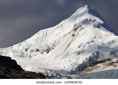 the northeast face of Nevado Tocllaraju mountain peak in the central Cordillera Blanca in the Andes of Peru in evening light
