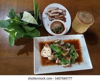 Northeast food in Thailand. Sticky rice,Charcoal-boiled pork neck,Slide grilled fish salad.