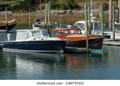 Northeast Harbor, Maine, USA - September 22, 2018: Older and newer style powerboats in adjoining slips in Northeast Harbor on last day of summer