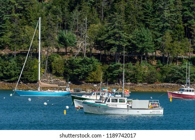 Northeast Harbor, Maine, USA - September 22, 2018: Line of boats moored in Northeast Harbor on last day of summer