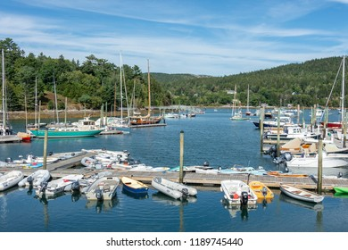 Northeast Harbor, Maine, USA - September 22, 2018: Boats moored in every direction in Northeast Harbor on last day of summer