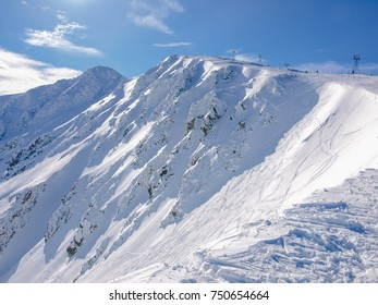 North-east slopes of the mountain Chopok on ski resort Jasna in winter day in Low Tatras mountains, Slovakia