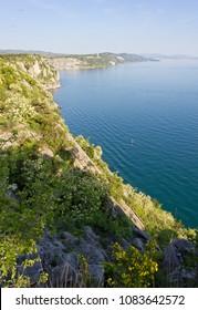 Northern adriatic rocky coast between Duino and Sistiana, near Trieste, Italy, in springtime