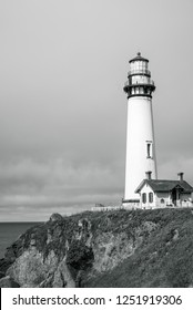 Northern California Pigeon Point Lighthouse and seascape natural pacific coast line with historic landmark Lighthouse black and white navigation location emergency tower