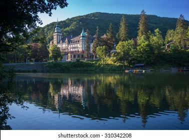 Northern front of Lillafured palace (Miskolc, Hungary). Lake Hamori in foreground, mountains covered with forest - background.