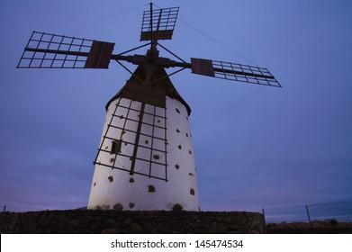 Northern Fuerteventura, traditional round windmill (molino), evening light