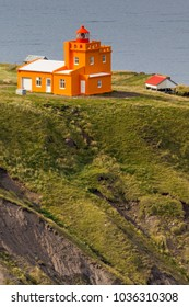 Northern Iceland - At the northernmost point of the coast of Iceland a magnificent orange lighthouse.