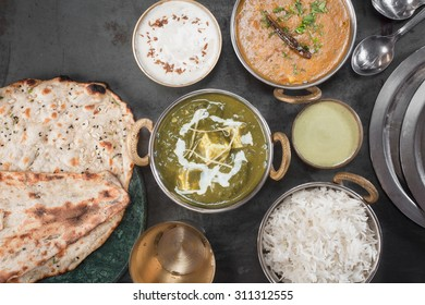 Northern Indian Dinner. Dal tadka, Palak Paneer, Green Chutney, Raita and Butter naan.
