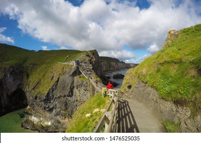 Northern Ireland - June 15,2017: Tourists waiting to cross the Rope Bridge: Carrick a rede in North Antrim, Northern Ireland on June 15,2017 -