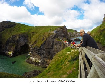 Northern Ireland - June 15,2017: Tourists waiting to cross the Rope Bridge: Carrick a rede in North Antrim, Northern Ireland on June 15,2017