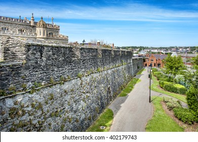 Northern Ireland, Londonderry: Panorama view of city wall with green park, famous Saint Columb's Cathedral, skyline, buildings in the city center of the Northern Irish town. June 23, 2015