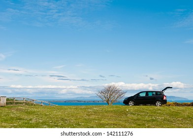 NORTHERN IRELAND - MAY 9: unidentified black suv at the countryside where a family decided to enjoy a holiday outdoors in Northern Ireland, United Kingdom on May 9, 2012.