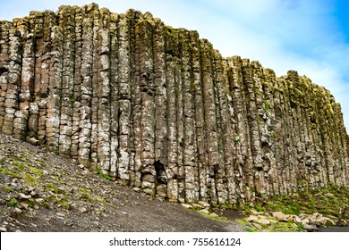 Northern Ireland: Side view of the interlocking geologic basalt columns, the result of an ancient volcanic eruption, at Giant's Causeway on the Atlantic ocean coastline.