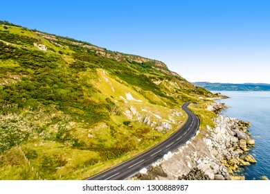 Northern Ireland, UK. Causeway Coastal Route a.k.a Antrim Coast Road. One of the most scenic coastal roads in Europe. Aerial view