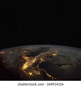 Northern  Italy at night from space, with stars above. Elements of this image furnished by NASA.