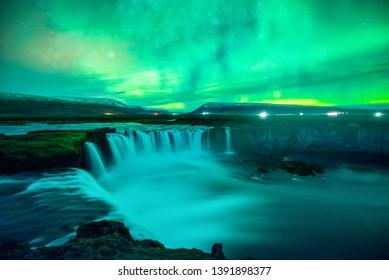 Northern Light, Aurora borealis at Godafoss waterfall in winter, Iceland.