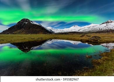 Northern light the Icelandic amazing paradise. Spectacular aurora borealis near the glacier lagoon Jokulsarlon in Iceland