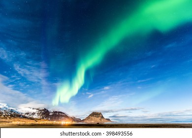 Northern Light over Grundarfjordur town, West Iceland spread through Kirkjufell
