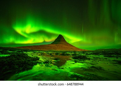 Northern light over Kirkjufell mountain in iceland