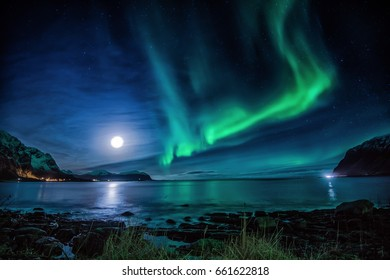 "Northern light at Vareidet in Flakstad, Lofoten islands. ""The flight of the dragon"""