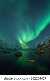 Northern Lights above coast in Ersfjordbotn, Norway