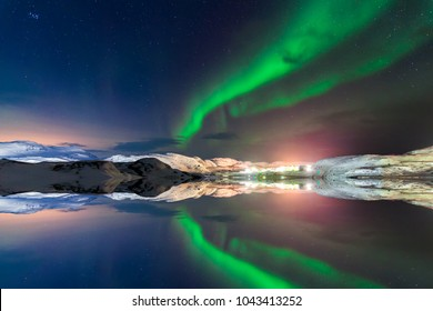 Northern lights above the fjord in Norway.