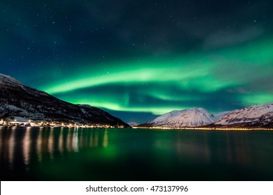 Northern lights above fjord - Winter in Norway