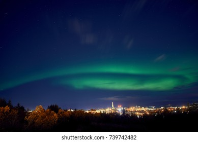 northern lights above Reykjavik in Iceland at night