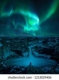 Northern lights at Aldeyjarfoss, Iceland. Aurora borealis at famous waterfall in Iceland.