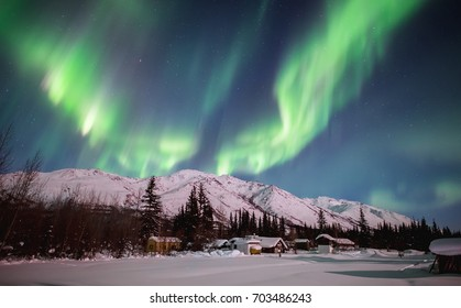 northern lights appear over arctic alaska's brooks mountains and wiseman village
