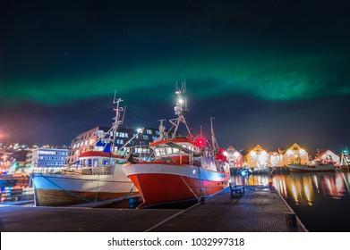 Northern lights (Aurora Borealis) above harbour of Tromsø, Norway