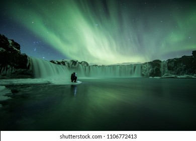 Northern Lights (Aurora Borealis) above Godafoss Waterfall, Iceland