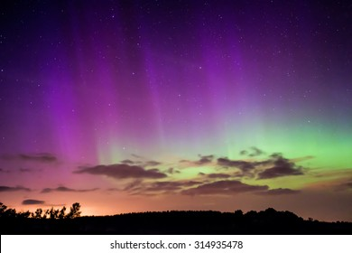 Northern Lights, Aurora Borealis displaying over a lake in Wisconsin.