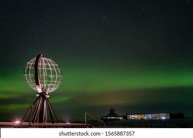 Northern lights, Aurora Borealis with the Globe, the monument at Nordkapp, North Cape, the most northern point of Europe, Finnmark, Norway