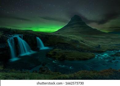 The Northern Lights (aurora borealis) in Kirkjufell Mountain in Iceland