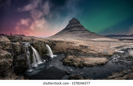 Northern lights aurora borealis over Kirkjufell mountain and waterfall in Iceland.