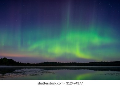 The northern lights, aurora borealis over a lake in Wisconsin.