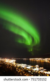 Northern lights (aurora borealis) over Tromso City in dark night, Norway