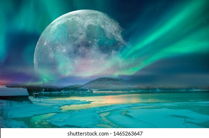 """Northern lights (Aurora borealis) in the sky with super full moon - Tromso,   Norway """"Elements of this image furnished by NASA"""""""