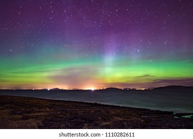 Northern lights aurora at seaside color norway