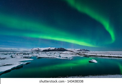 The Northern Lights dance over the glacier lagoon in Iceland.
