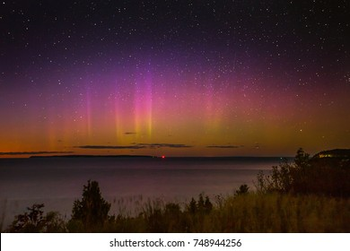 The northern lights dance over Lake Michigan and the Manitou islands in Sleeping Bear Dunes National Lakeshore in northern Michigan