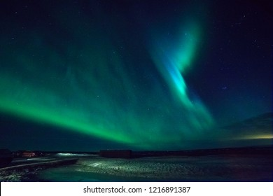 Northern lights dancing at the sky