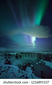 Northern Lights at Godafoss waterfall in winter, Iceland.